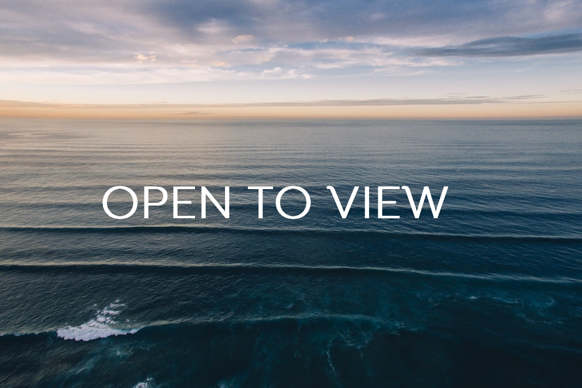 The ocean as sunset as seen from a drone